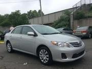 Серебряный цвет Toyota Corolla 2013 модельного,